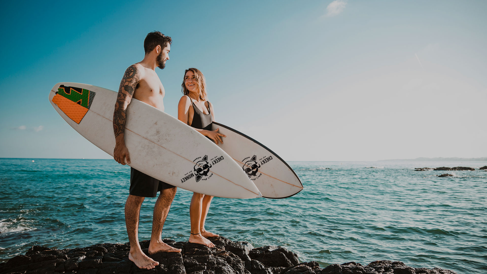 Surf couple on the beach with Cheeky Monkey surf boards