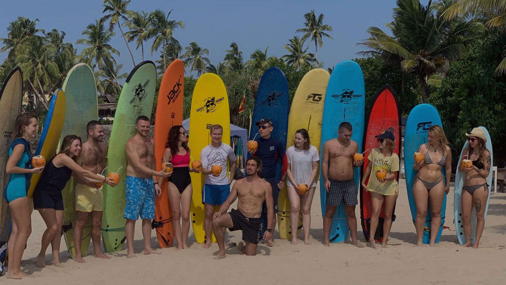 Surfers with surfboards at Cheeky Monkey srf camp