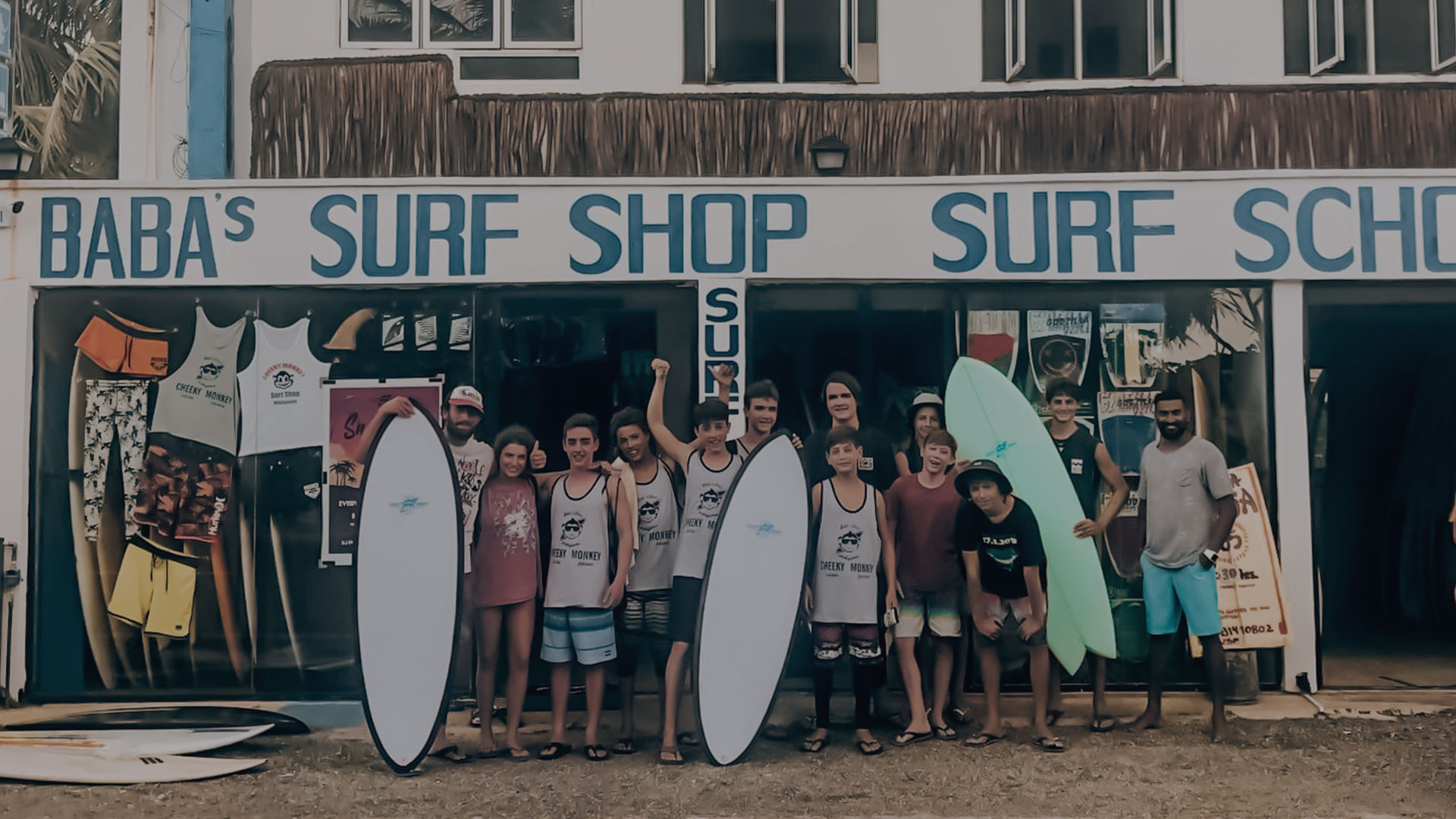 Happy clients in front of the Baba's surf shop