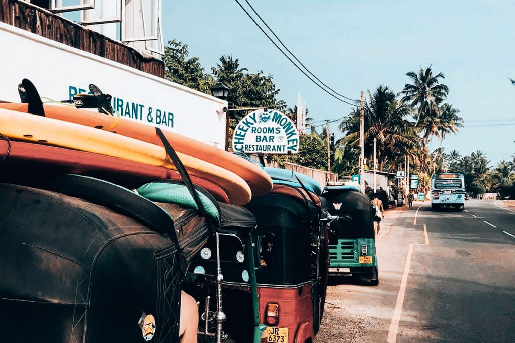 Outside view of Cheeky Monkey surf camp with the road