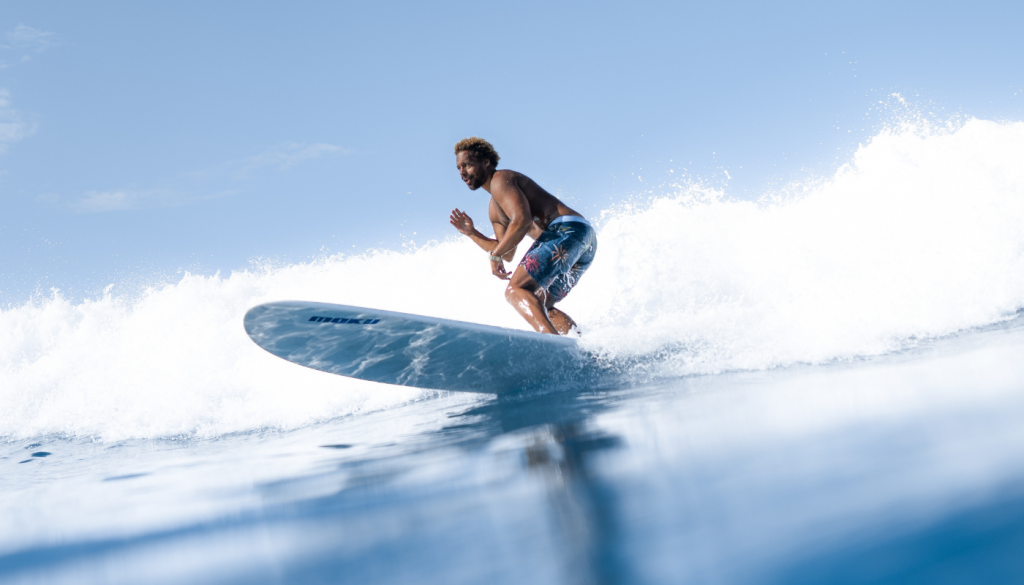 A surfer surfing to improve his skills