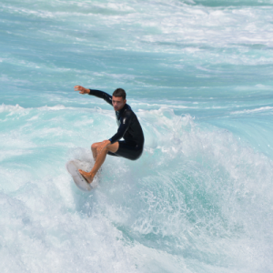 A surfer engaging with his daily surf sessions