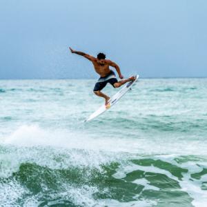 Surfer enjoy waves in Sri Lanka