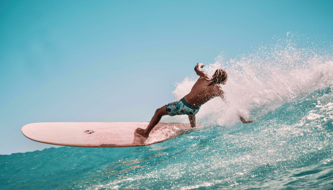 A surfer surfing with a positive mind