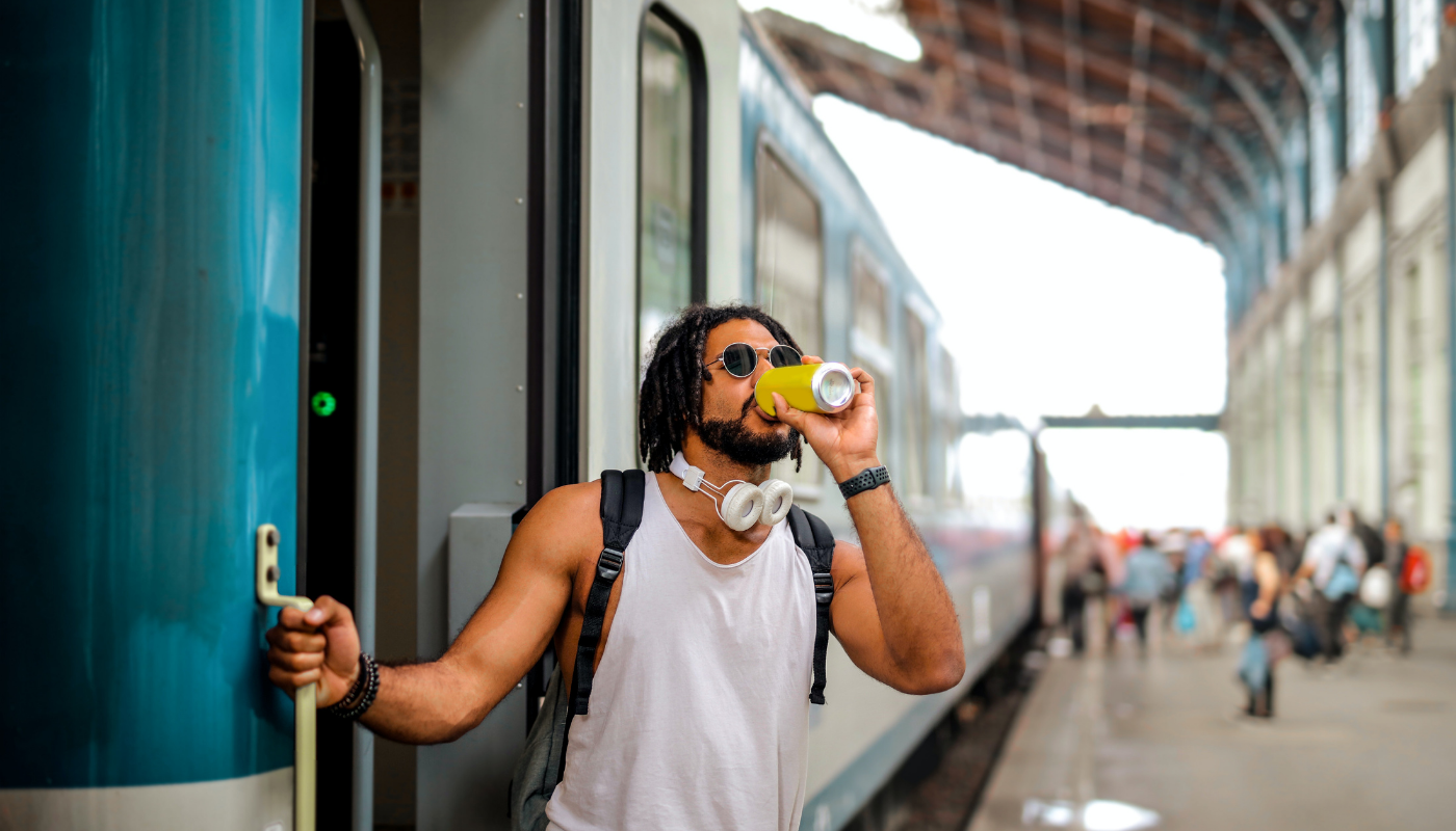 A surfer traveling by train during a surf trip in Sri Lanka