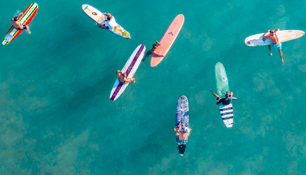 Surfers floating on surfboards