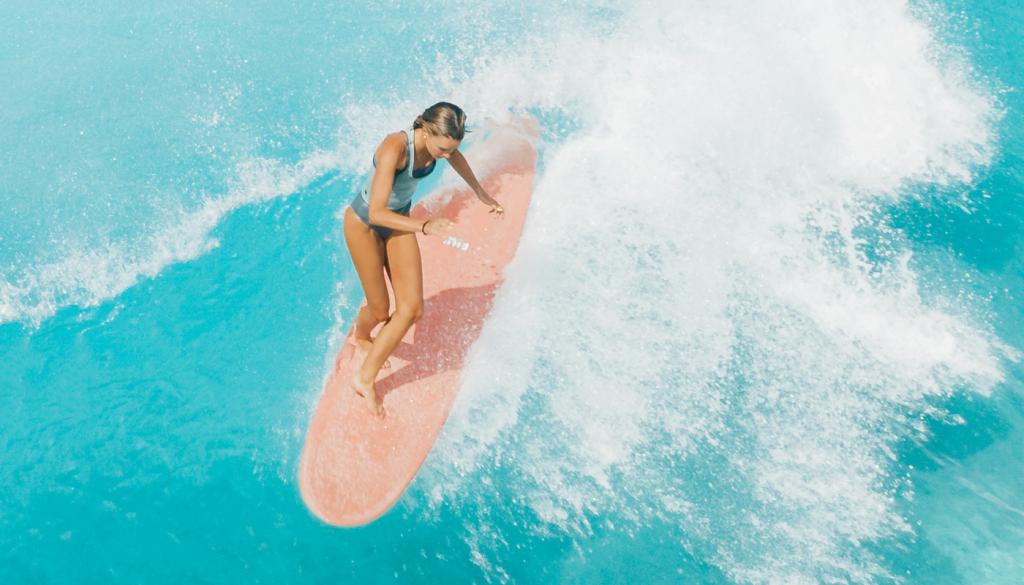 A surfer enjoying waves in Midigama